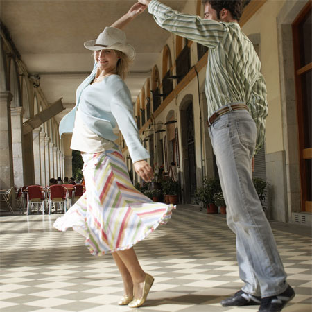 Young Couple Dancing --- Image by © Royalty-Free/Corbis